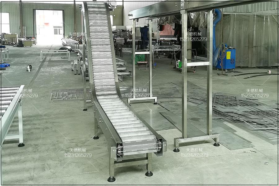 汕尾牙膏生产线爬坡输送机不锈钢输...